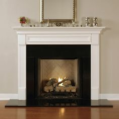 Fireplace - similar to ours - I'm liking the black surround with black hearth - on wood floor!  Love, love, love!