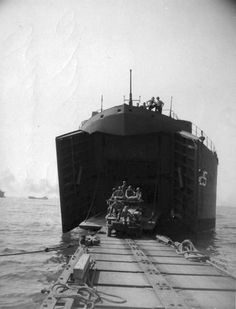 Unloading across pontoon causeway at Salerno, Sep '43. 13 September LST-325 sailed as part of the Northern Attack Force in support of the invasion at Salerno, Italy carrying elements of the 40th Royal Tank Regiment. Four members of the crew and four British soldiers were injured during an attack by German fighter-bombers as the ship entered the attack area. LST-325 made three trips to the beachhead at Salerno, the last trip carrying members of a Ceylanese infantry regiment from Tripoli…