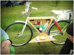 Talk about summer living! This bicycle has been outfitted with a custom-fit box to stash a few bar basics. The box also doubles as a table, so you can have your own outdoor cocktail hour. Just pick a park, or a field, or the side of the road!