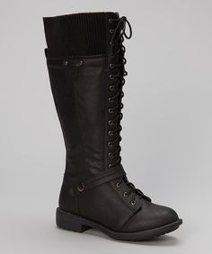 """Strut through the city with style in these confidence-boosting boots. Their fashionable laces, decorative buckles and hint of heel lend rugged glamour to any ensemble.1"""" heel13.5'' shaft14.5'' circumferenceLace-up / inside zipper closureMan-made"""