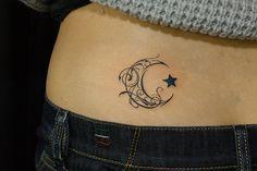 crescent moon tribal tattoo by naoto,TIFANA TATTOO