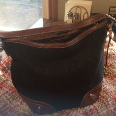 Etienne Aigner Purse Beautiful black and brown handbag in great condition. Great bag for anyone with a tight budget! Etienne Aigner Bags Shoulder Bags