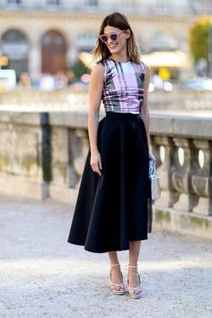 Hanelli Mustaparta in a checked blouse and full skirt