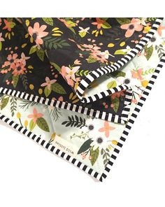 Our Wholecloth Quilts make a wonderful, thoughtful gift for an expecting or new mom. Perfect to drape over the side of a crib and easily transitions to toddler bedding. Used as a play mat for the floor or tummy time, spread out for a picnic or for cuddling and snuggling. Designer high quality cotton fabrics and thread. Cozy batting is Warm Company cotton brand. This Wholecloth Quilt is made with a contrasting mint green and black boho floral indie pattern fabric and eye popping black and…