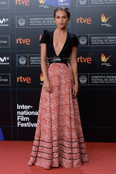 """Alicia Vikander wearing a Louis Vuitton Cruise 2018 custom made gown to the """"Submergence"""" premiere, during the 65th San Sebastian film festival."""