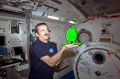"Chris Hadfield's grand April Fools' Day finale shows him posing with an alien that just stopped by the station to say hi. ""I don't know what it is or what it wants, but it keeps repeating 'Sloof Lirpa' over and over. Alert the press."" (April 1, 2013) Mona Evans, ""Astronomy April Fools"" http://www.bellaonline.com/articles/art183019.asp"