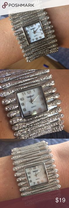 VINTAGE QUARTZ Silver Women's Cuff Watch From a collection of estate jewelry - very nice silver Quartz cuff watch in excellent condition. quartz Jewelry