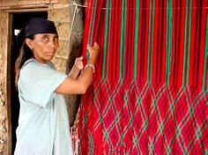 Wayuu woman weaving. Characteristic for the fabrics are the decorating patterns inspired by nature and what the culture sees around. Wayuu culture is known for crafts such as bags or mochilas. Wayuu of northwest Venezuela and northern Columbia.