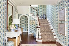 Make an Entrance - Best Houses of 2016 - Southernliving. In our September feature house, Nashville designer, Sarah Bartholomew carried around a sample of this Pierre Frey batik inspired wallpaper (Toiles des Nantes) for years until she had the perfect place for it – her own foyer. To play it up, she layered on other classic blue and white accessories: a garden stool, a skirted chair, and lots of ginger jars.