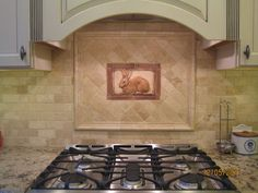 Kitchen tiled backsplash with handcrafted rabbit tile as an decorative accent