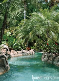 A lush landscape design and stunning swimming pool create a fun retreat for all ages