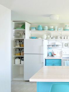 These homeowners created the look of built-ins by lining up shelving with the top of the refrigerator.
