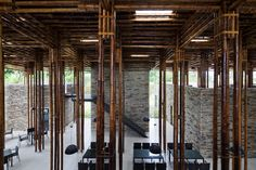 Clustered lengths of bamboo create a forest of columns in the open-air dining room of this Vietnam restaurant by Vo Trong Nghia Architects. Bamboo Architecture, Studios Architecture, Unique Architecture, Tropical Architecture, House Construction Plan, Bamboo Construction, Facade Design, Roof Design, Bamboo Building