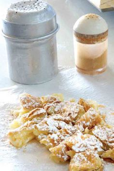 Greek bougatsa filled with cream, topped with cinnamon and thin sugar