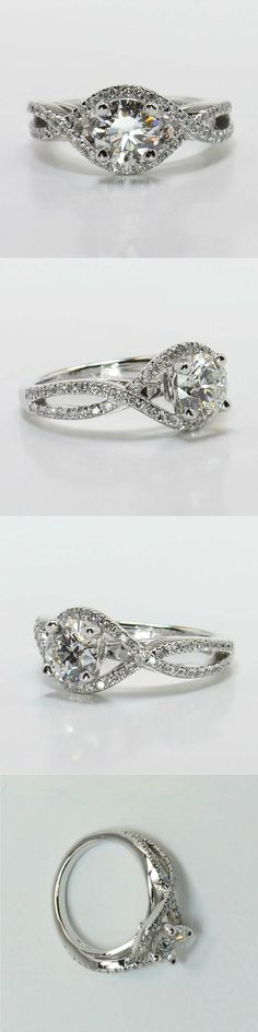Cross Split Shank Diamond Ring in White Gold! Diamond/Gem Cost: $4,623 (Round 0.90 Ctw. Color: G Clarity: SI1 Cut: Super Ideal) Setting Cost: $1,195 This unique swirl engagement ring features pave set diamonds on interlocking bands surrounding the center stone. Metal: White Gold Side Shape: Round Side Carat: 0.40 Setting Type: Pave! Total Cost: $5,818 www.brilliance.com