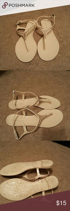 Silly Jelly ??REPOSH?? THESE ARE SO CUTE BUT JUST NOT MY STYLE OR FIT. THEY ARE A SIZE 9 BUT MORE FOR A SHAPED (ARCHED SLIM) FOOT. THEY ARE JELLY SANDALS WITH EBELLISHMENTS ON TOP. They say  size 10 but im a 9 and they are snug so no way a 10 could wear these. Chinese Laundry Shoes Sandals