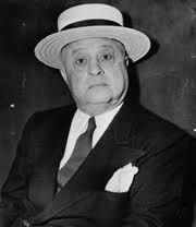 "Jake ""Greasy Thumb"" Guzik (March 20, 1886 – February 21, 1956) was the financial and legal advisor, and later political ""greaser,"" for the Chicago Outfit. Guzik worked for Capone, and later Paul ""the Waiter"" Ricca and Tony Accardo. During the 1940s and 1950s, when the national syndicate was dominated by what was called the Big Six, it was Guzik and Accardo who flew east weekly to meet with the other heads of the organization: Joe Adonis, Frank Costello, Meyer Lansky and Longy Zwillman."