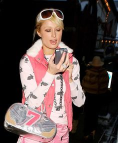 Late January 2005: Paris goes back to her thick-ass BlackBerry with what appears to be a very 2005 Juicy Couture bag. | Every Single One Of Paris Hilton's Cell Phones