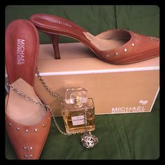 Michael Kors Astor Mules  2005 NWOT Brand new Michael Kor all Leather mules with Silver Studs and kitten heels. Size 8 1/2. Comes with original box bought in 2005. Never been wore. Smoke free. Michael Kors Shoes Mules & Clogs
