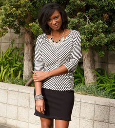Mitered black and white stripes get grounded by an ebony, leg-baring skirt to create perfect style symmetry.