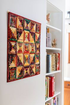 From the Archives: A log cabin quilt, one of many, hangs on the wall of Judy Martin's Grinnell, Iowa home. For more on Judy Martin, see page 126 in Issue 02: Iowa.
