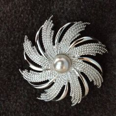 Vintage Sarah Coventry Brooch Silvery Sunburst. Faux pearl. Roll over type clasp. Very nice condition. Sarah Coventry Jewelry Brooches