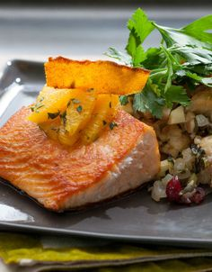 A side dish for seared salmon, this savory stuffing is dotted with cranberries and crunchy walnuts. We candied the orange peel to create an intensely bittersweet flavor perfect for both the salmon and stuffing. Orange Recipes, Salmon Recipes, Seafood Recipes, Cranberry Recipes, Fish Recipes, Salmon Dishes, Fish Dishes, Seafood Dishes, Candied Orange Peel