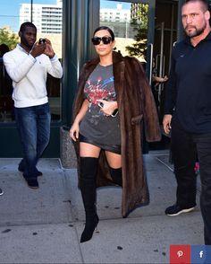 Kim Kardashian wearing BLACK OVER THE KNEE BOOTS w/ black leather mini skirt, Pink Floyd tee & mink coat w/ signature Celine sunglasses