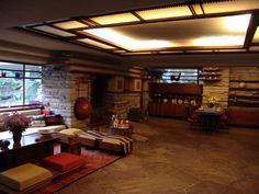 Fallingwater living room and dining area, Frank Lloyd Wright, architect (Kaufmann house above the waterfall) Casas De Frank Lloyd Wright, Frank Lloyd Wright Buildings, Frank Lloyd Wright Homes, Red House William Morris, Robie House, Fallingwater Interior, Casa Kaufmann, Casa Farnsworth, Falling Water Frank Lloyd Wright