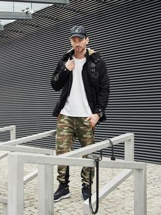 Sport and military winter look from the Bolf collection. The comfy black parka jacket matches well with a basic long sleeve top and practical camo joggers. As an accessory, we offer a sport watch.
