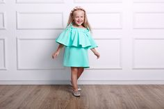 This stretch crepe mini dress has a flexible off-the-shoulder neckline that creates a tiered silhouette. It has an easy, loose fit and flouncy ruffles at the shoulder. Comfortable for active children. Ruffle Dress, Ruffles, Off The Shoulder, Shoulder Dress, Candy Dress, Loose Fit, Kids Fashion, Neckline, Silhouette