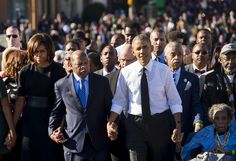 Walking alongside many of the original marchers, President Obama makes his way across the Edmund Pettus Bridge to mark the 50th Anniversary of the Selma to Montgomery civil rights marches in Selma, Alabama, on March 7.