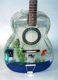 Buy a fish and name it cat. I love the guitar for the tank. That's so cool! … Buy a fish and name it cat. I love the guitar for the tank. That's so cool! Aquarium Design, Home Aquarium, Aquarium Fish, Fish Aquariums, Aquarium Ideas, Tanked Aquariums, Guitar Art, Cool Guitar, Guitar Shelf