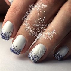 The Blue Shimmered White Nails Embossed with White Vine. Embossed nails are my personal favorite, so I've included a few in this article. This blue and white embossed nail art will definitely catch your mind.
