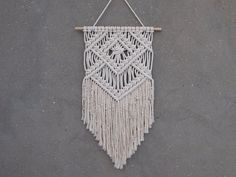 Color: off-white. Material: unbleached cotton rope, wood. Length of the wood is approx 41 cm (16 inches); macrame canvas is approx max 69 cm (27...