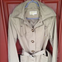 Michael Kors Trench coat.Firm NWOT never worn excellent condition no stains no rips.Price dripped from $120 no offers accepted Michael Kors Jackets & Coats Trench Coats