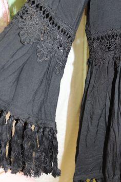 Fringe hem really makes this black kimono cardigan with lace insets. 100% rayon