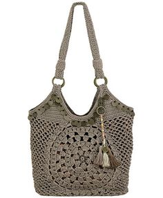 """The Sak Ellis Crochet Tote Imported Polypropylene; lining: nylon Double handles with 11"""" drop Zipper closure Exterior features silver- or brass-tone ahrdware Interior features 1 zip pocket and 2 multifunction pockets 10"""" W x 13"""" H x 6-1/2"""" D Silhouette is based off 5'9"""" model"""
