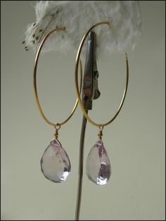 rose de france amethyst briolettes drip from dainty 14k gold fill hoops. adove fine jewelry.