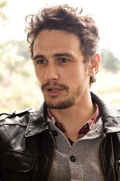 james franco style - wavy hair, longer at top fade to short at the neck. sexy scruffy facial hair style