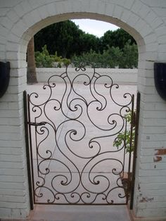 love the wrought iron gate