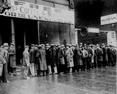 """Unemployed men queued outside a depression soup kitchen opened in Chicago by Al Capone. The storefront sign reads """"Free Soup, Coffee and Doughnuts for the Unemployed."""" February 1931"""