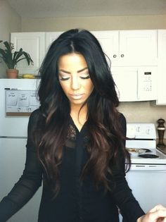 DARK brown with medium lighter brown highlights/lowlights towards the underneath and some on top to give dimension