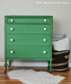 A mossy green dresser with white rose knobs - The Weathered Door