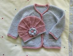 An adorable set, soft and pretty... a perfect baby girl gift. The cardigan has been knitted in one piece so there are no seams, making it very
