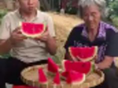 a watermelon eating competition between grandma and grandson. Viral Videos, Watermelon, Competition, Eat