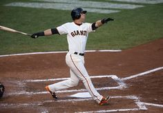 Joe Panik (12) follows the flight of his two-run home run bringing Gregor Blanco in the third inning of Game 5 of the National League baseball championship series against the St. Louis Cardinals at AT&T Park in San Francisco, Calif., on Thursday, Oct. 16, 2014. (Jane Tyska/Bay Area News Group)