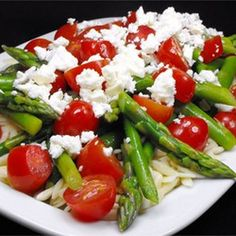 Asparagus, Feta and Couscous Salad Recipe Salads with couscous, fresh asparagus, grape tomatoes, feta cheese, balsamic vinegar, extra-virgin olive oil, black pepper