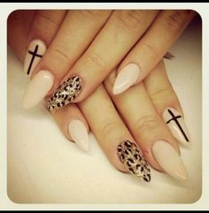 love just a hint of animal print with the accents. Stiletto nails are the only way to go<3