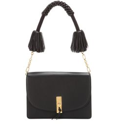 Altuzarra - Ghianda leather shoulder bag - Altuzarra's 'Ghianda' shoulder bag is crafted from dark black leather for a sharp, defined look that contrasts the bohemian flair of the chunky strap. Brilliant gold-tone chain hardware gives the braided, tasselled leather design an undeniably glamorous look. Carry yours in the crook of your arm next to a linen blazer for a refined effect. seen @ www.mytheresa.com